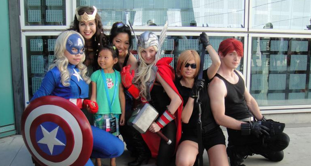 Genderswapped Avengers posing with small girl.