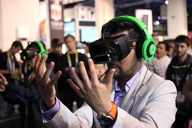 Man wearing VR headset looking at his hands.