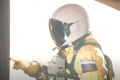 a still of a live-action yellow astronaut from Among Us